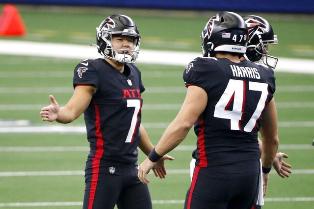 Atlanta Falcons kicker Younghoe Koo (7) and long snapper Josh Harris (47) celebrate a field goal kicked by Koo in the first half of an NFL football game against the Dallas Cowboys in Arlington, Texas, Sunday, Sept. 20, 2020. (AP Photo/Ron Jenkins)