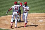 Los Angeles Angels' Justin Upton, right, celebrates his solo home run with Jo Adell in the second inning of a baseball game against the Seattle Mariners in Anaheim, Calif., Monday, Aug. 31, 2020. (AP Photo/Kyusung Gong)