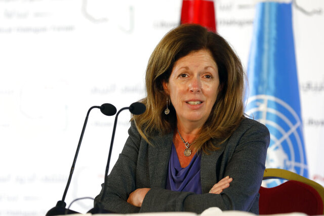 Stephanie Williams, Acting Special Representative of the Secretary-General and Head of the United Nations Support Mission speaks during a news conference in Tunis, Tunisia, Sunday, Nov. 15, 2020. Libya's warring sides have agreed to hold nationwide elections in December next year, the top U.N. official for the North African country said Friday in a sign of progress from the U.N.-brokered peace talks underway in Tunisia.  (AP Photo/Walid Haddad)