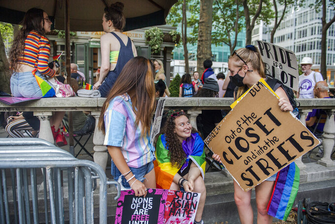 People gather at Bryant Park for the Queer Liberation March on Sunday, June 27, 2021, in New York. (AP Photo/Brittainy Newman)