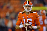 Clemson quarterback Trevor Lawrence warms up before the start of an NCAA college football game against South Carolina, Saturday, Nov. 24, 2018, in Clemson, S.C. (AP Photo/Richard Shiro)