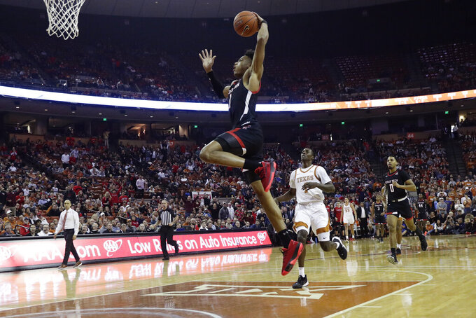 Texas Tech guard Terrence Shannon Jr. (1) drives to the basket for a score against Texas during the first half of an NCAA college basketball game, Saturday, Feb. 8, 2020, in Austin, Texas. (AP Photo/Eric Gay)