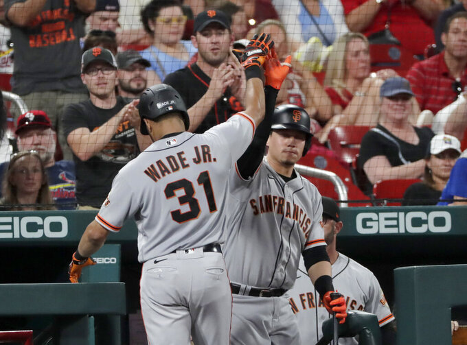 San Francisco Giants' LaMonte Wade Jr. (31) celebrates with Wilmer Flores after hitting a three-run home run in the fifth inning of the team's baseball game against the St. Louis Cardinals, Friday, July 16, 2021, in St. Louis. (AP Photo/Tom Gannam)