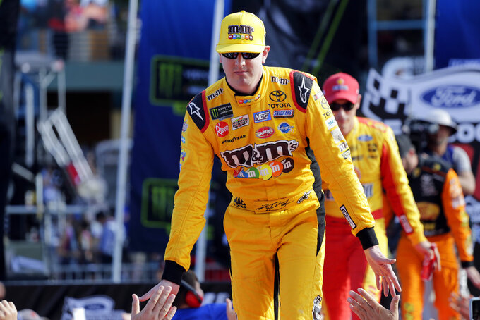 Kyle Busch is introduced before a NASCAR Cup Series Championship auto race at the Homestead-Miami Speedway, Sunday, Nov. 18, 2018, in Homestead, Fla. (AP Photo/Terry Renna)