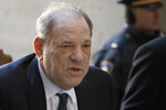 FILE- In this Feb. 21, 2020, file photo, Harvey Weinstein arrives at a Manhattan court in New York, as jury deliberations continue in his rape trial. On Friday, Oct. 30, Mimi Haleyi, who testified against Weinstein, filed a lawsuit against him seeking damages for what she described as lasting injuries. The former