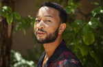 In this June 13, 2020 photo, singer-songwriter John Legend appears during a photo session at The Bel Air Hotel in Beverly Hills, Calif., to promote his latest album