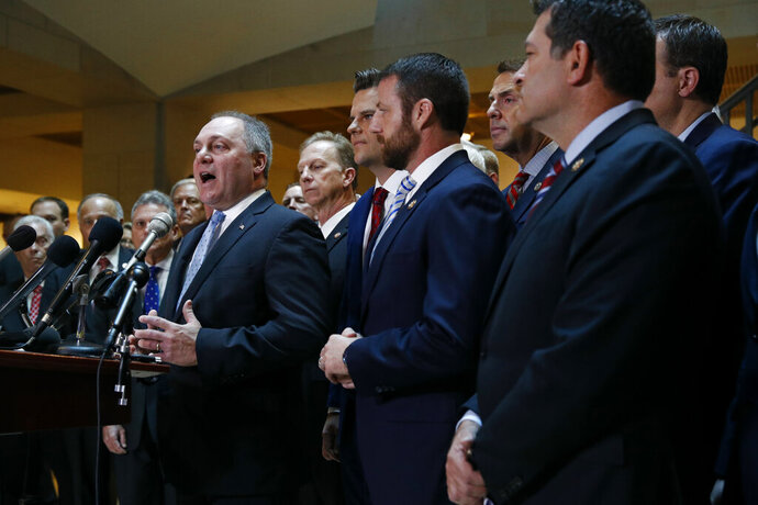 House Minority Whip Steve Scalise, R-La., left, speaks at a news conference in front of House Republicans after Deputy Assistant Secretary of Defense Laura Cooper arrived for a closed door meeting to testify as part of the House impeachment inquiry into President Donald Trump, Wednesday, Oct. 23, 2019, on Capitol Hill in Washington. (AP Photo/Patrick Semansky)
