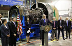 FILE - In this June 6, 2018 file photo, Washington Gov. Jay Inslee, center, speaks in front of an airplane engine at South Seattle College in Seattle. Washington state lawmakers announced Wednesday, Feb. 19, 2020 that they will introduce bills, at Boeing Co.'s request, to suspend the company's preferential business and occupation tax rate until there's a final determination from World Trade Organization regarding a long-running trade dispute. (AP Photo/Ted S. Warren, File)