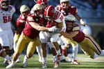 Boston College defensive back Tate Haynes, right, and linebacker Vinny DePalma, left, tackle North Carolina State running back Jordan Houston (20) during the second half of an NCAA college football game in Boston, Saturday, Oct. 19, 2019. (AP Photo/Michael Dwyer)