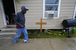 Earnst Jack, whose home was severely damaged from Hurricane Laura, walks in front of his house as he waits for the arrival of Hurricane Delta expected to make landfall later in the day in Lake Charles, La., Friday, Oct. 9, 2020. (AP Photo/Gerald Herbert)