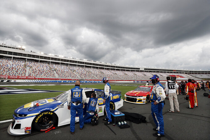 Dark clouds fill the sky over Charlotte Motor Speedway before the start of the NASCAR Cup Series auto race Sunday, May 24, 2020, in Concord, N.C. (AP Photo/Gerry Broome)