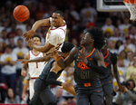 Iowa State guard Talen Horton-Tucker, left, throws the ball for a breakaway during the first half of the team's NCAA college basketball game against Oklahoma State, Saturday, Jan. 19, 2019, in Ames. At right is Oklahoma State's Isaac Likekele. (AP Photo/Matthew Putney)
