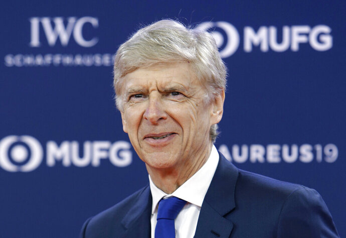 FILE - In this Monday, Feb. 18, 2019 file photo, former Arsenal soccer team manager Arsene Wenger arrives for the 2019 Laureus World Sports Awards. FIFA says it hired Arsene Wenger in a full-time role leading its global work developing soccer. Wenger accepted FIFA's offer more than two months after it was reported, and one week after talks with Bayern Munich about the German champion's vacant head coach job. He will oversee the rules-making panel known as IFAB, coaching programs and technical analysis of games at FIFA tournaments.  (AP Photo/Claude Paris, File)