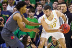 Notre Dame's John Mooney (33) gets pressure from Louisville's Dwayne Sutton (24) during the first half of an NCAA college basketball game Saturday, Jan. 11, 2020, in South Bend, Ind. (AP Photo/Robert Franklin)