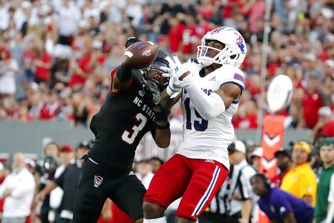 North Carolina State's Aydan White (3) breaks up a pass intended for Louisiana Tech's Bub Means (15) but is called for interference during the first half of an NCAA college football game in Raleigh, N.C., Saturday, Oct. 2, 2021. (AP Photo/Karl B DeBlaker)