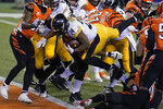 Pittsburgh Steelers' Benny Snell (24) goes in for a touchdown during the second half of an NFL football game against the Cincinnati Bengals, Monday, Dec. 21, 2020, in Cincinnati. (AP Photo/Michael Conroy)