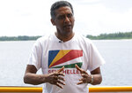 Seychelles President Danny Faure speaks during an interview with the Associated Press, on the island of Desroches, Seychelles on Sunday April 14, 2019. In a striking speech delivered from deep below the ocean's surface, the Seychelles president on Sunday made a global plea for stronger protection of the