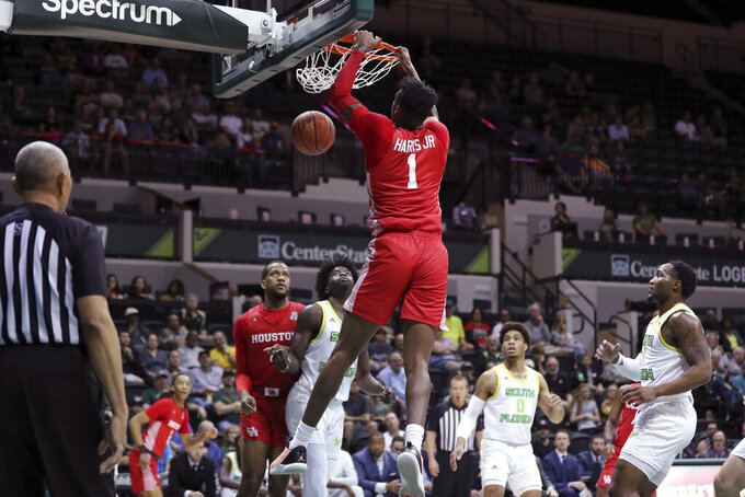 Houston's Chris Harris Jr. dunks against South Florida during the first half of an NCAA college basketball game Wednesday, Feb. 12, 2020, in Tampa, Fla. (AP Photo/Mike Carlson)