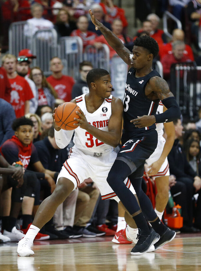 Ohio State's E.J. Liddell, left, looks for an open pass as Cincinnati's Tre Scott defends during the first half of an NCAA college basketball game Wednesday, Nov. 6, 2019, in Columbus, Ohio. (AP Photo/Jay LaPrete)
