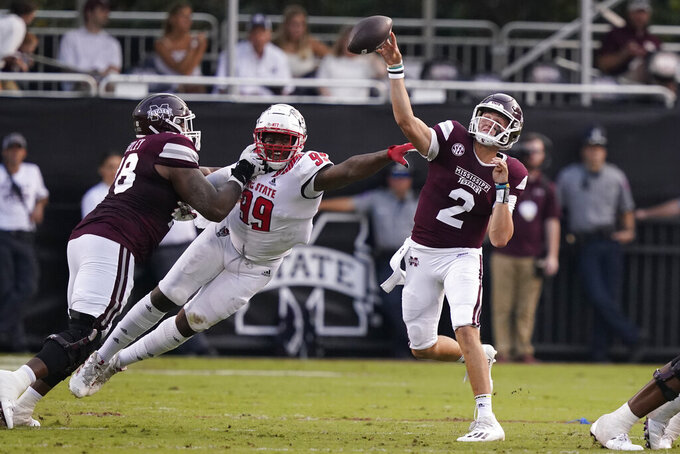 North Carolina State defensive lineman Daniel Joseph (99) disrupts a pass attempt by Mississippi State quarterback Will Rogers (2) during the first half of an NCAA college football game in Starkville, Miss., Saturday, Sept. 11, 2021. (AP Photo/Rogelio V. Solis)