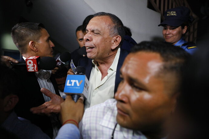 FILE - In this Aug. 20, 2019 file photo, former Honduran President Porfirio Lobo speaks to the press outside court where his wife, former first lady Rosa Elena Bonilla de Lobo, was convicted on corruption charges in Tegucigalpa, Honduras. A former drug boss Devis Leonel Rivera Maradiaga testified in court on Friday, Oct. 11, that he had paid a bit more than half a million dollars to Lobo in exchange for protection from being extradited to the United States. (AP Photo/Elmer Martinez, File)