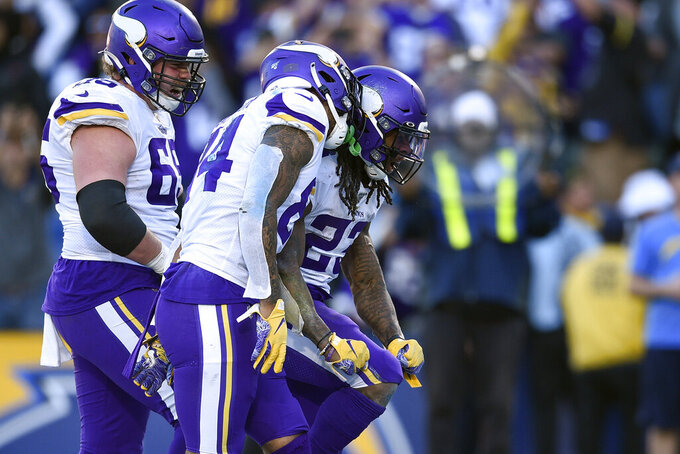 Minnesota Vikings running back Mike Boone, right, celebrates with teammates after scoring a touchdown during the second half of an NFL football game against the Los Angeles Chargers Sunday, Dec. 15, 2019, in Carson, Calif. (AP Photo/Kelvin Kuo)