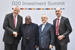 Stefan Liebing, left, chairman of the German'African Business Association (Afrika-Verein der deutschen Wirtschaft), Heinz-Walter Grosse, second from right, chairman of the Sub-Saharan Africa Initiative of German Business (SAFRI) and Michael Blank, right, chairman of AHK Ghana (Delegation of German Industry and Commerce in Ghana), pose with Ghana's President Nana Akufo-Addo, 2nd from left, as he arrives to attend the