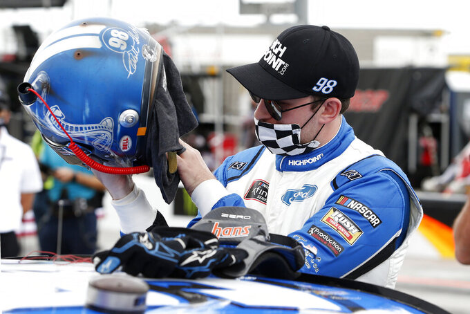 Chase Briscoe looks over his helmet prior to the NASCAR Xfinity Series auto race at Phoenix Raceway, Saturday, Nov. 7, 2020, in Avondale, Ariz. (AP Photo/Ralph Freso)