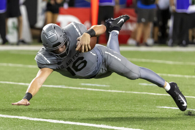 Air Force quarterback Mike Schmidt (16) dives in for a touchdown during the second half of an NCAA college football game, Saturday, Oct. 19, 2019, in Honolulu. Air Force beat Hawaii 56-26. (AP Photo/Eugene Tanner)
