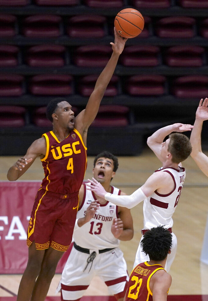 Southern California forward Evan Mobley (4) blocks a shot by Stanford guard Noah Taitz (20) during the second half of an NCAA college basketball game in Stanford, Calif., Tuesday, Feb. 2, 2021. Southern California won 72-66.(AP Photo/Tony Avelar)