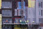 In this June 14, 2019 photo, construction workers perform tasks on an apartment building in Orlando, Fla. On Wednesday, July 17, the Commerce Department reports on U.S. home construction in June. (AP Photo/John Raoux)