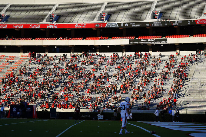 Georgia students gather in the stands before Georgia's NCAA college football game against Auburn, Saturday, Oct. 3, 2020, in Athens, Ga. (AP Photo/Brynn Anderson)