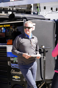 Jeff Burton, broadcaster and former driver, is seen before a NASCAR Xfinity Series auto race at Texas Motor Speedway Saturday, Oct. 16, 2021, in Fort Worth, Texas. (AP Photo/Larry Papke)
