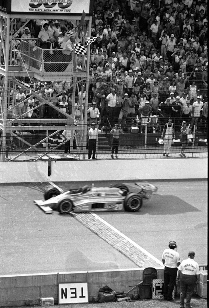 FILE - In this May 30, 1982, file photo, championship driver Gordon Johncock pilots his Wildcat-Cosworth across the finish line to take the checkered flag and win the Indianapolis 500-mile race in Indianapolis. The Associated Press has updated its survey of living Indianapolis 500 winners and their pick as the greatest race in the long history of the event. There are six races that received multiple votes, topped by Al Unser Jr.'s victory over Scott Goodyear in 1992 — the closest Indy 500 in history. The others are Emerson Fittipaldi's win in 1989; Sam Hornish Junior's win in 2006; the 1982 battle between Rick Mears and Johncock; the 2011 race won by the late Dan Wheldon; and the 2014 thriller won by Ryan Hunter-Reay. (AP Photo, File)