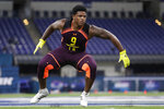 FILE - In this March 3, 2019, file photo, Michigan linebacker Devin Bush runs a drill at the NFL football scouting combine, in Indianapolis. Bush is a possible pick in the 2019 NFL Draft. (AP Photo/Michael Conroy, File)