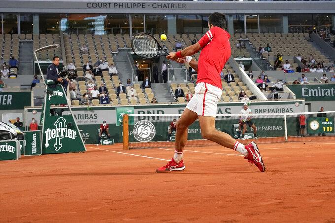 Serbia's Novak Djokovic returns the ball to Italy's Matteo Berrettini during their quarterfinal match of the French Open tennis tournament at the Roland Garros stadium Wednesday, June 9, 2021 in Paris. (AP Photo/Michel Euler)