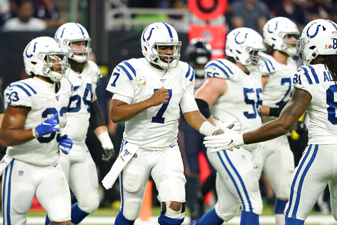 Indianapolis Colts quarterback Jacoby Brissett (7) celebrates with teammates after a touchdown against the Houston Texans during the first half of an NFL football game Thursday, Nov. 21, 2019, in Houston. (AP Photo/David J. Phillip)