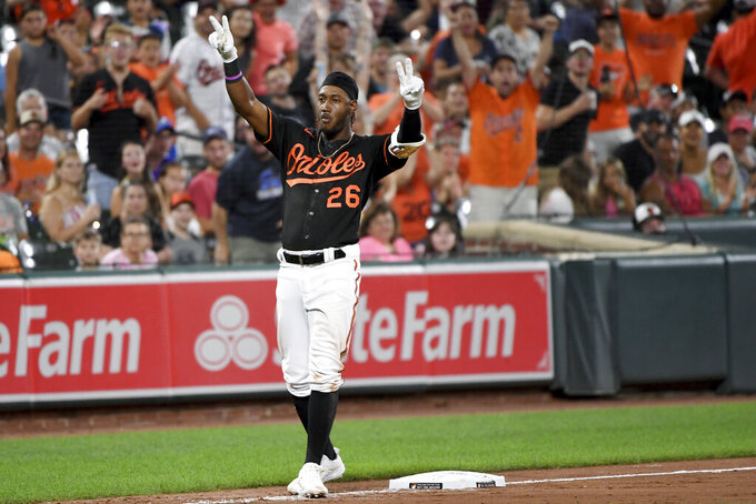 Baltimore Orioles' Jorge Mateo celebrates after hitting an RBI triple against the Tampa Bay Rays during the fifth inning of a baseball game Friday, Aug. 6, 2021, in Baltimore. (AP Photo/Will Newton)