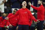 Connecticut Huskies head coach Dan Hurley reacts from the sideline during the second half  of an NCAA college basketball game Saturday, Feb. 27, 2021, in Storrs, Conn. (David Butler II/Pool Photo via AP)