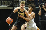 Purdue center Matt Haarms, left, is fouled by Texas forward Jericho Sims in the first half of an NCAA college basketball game in West Lafayette, Ind., Saturday, Nov. 9, 2019. (AP Photo/AJ Mast)