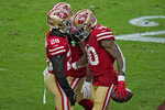 San Francisco 49ers running back Jeff Wilson (30) celebrates his touchdown with running back Jerick McKinnon (28) during the first half of an NFL football game against the Washington Football Team, Sunday, Dec. 13, 2020, in Glendale, Ariz. (AP Photo/Ross D. Franklin)
