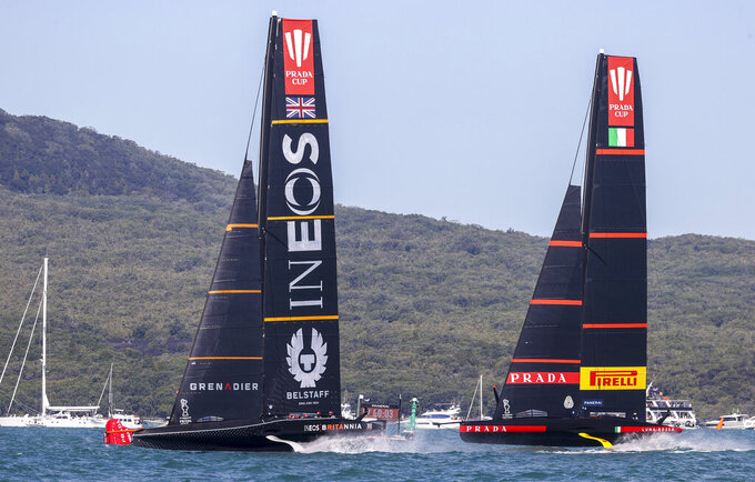 Britain's INEOS Team UK, left, and Italy's Luna Rossa in race seven of the Prada Cup on Auckland's Waitemata Harbour, New Zealand, Sunday, Feb. 21, 2021. (Brett Phibbs/NZ Herald via AP)
