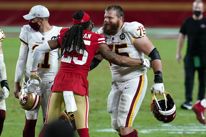 San Francisco 49ers cornerback Richard Sherman (25) greets Washington Football Team offensive guard Brandon Scherff (75) after an NFL football game, Sunday, Dec. 13, 2020, in Glendale, Ariz. Washington won 23-15. (AP Photo/Ross D. Franklin)