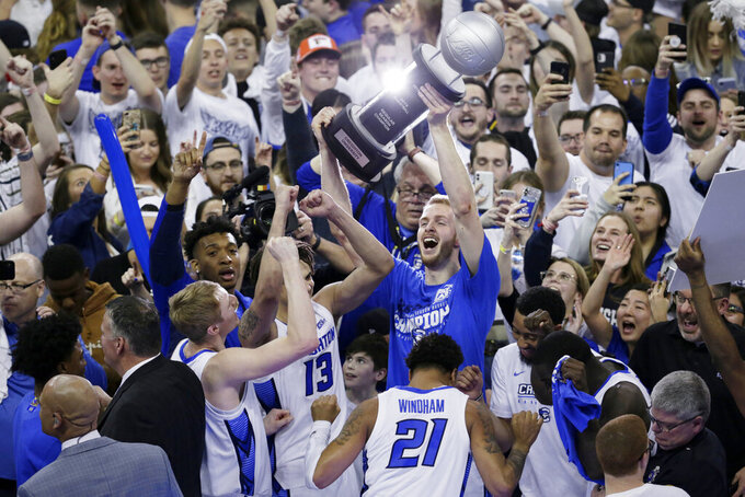 Creighton players hoist the Big East regular season championship trophy following a 77-60 win over Seton Hall, in an NCAA college basketball game in Omaha, Neb., Saturday, March 7, 2020. (AP Photo/Nati Harnik)