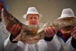 Britain's Prime Minister and Conservative Party leader Boris Johnson visits Grimsby fish market in Grimsby, northeast England, Monday Dec. 9, 2019, ahead of the general election on Dec. 12. All 650 seats in the House of Commons are up for grabs Thursday when voters will pass judgement on a divisive election that will determine Britain's future with European Union. (Ben Stansall/Pool via AP)