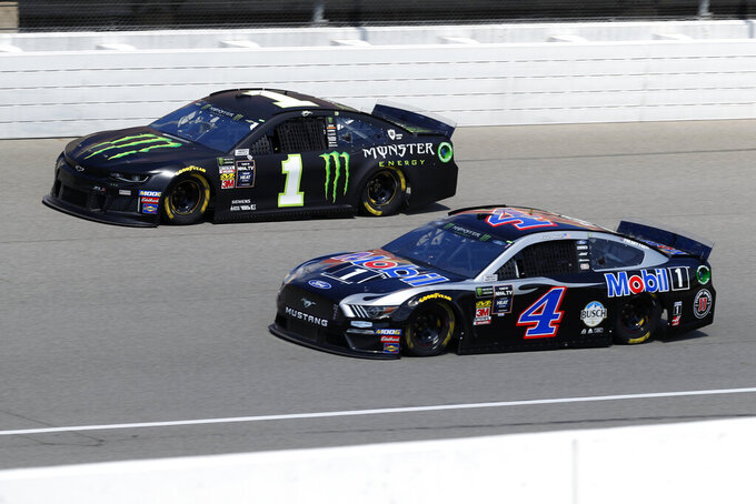 Kurt Busch (1) and Kevin Harvick (4) practice for a NASCAR Cup Series auto race at Michigan International Speedway in Brooklyn, Mich., Saturday, Aug. 10, 2019. (AP Photo/Paul Sancya)