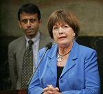 FILE - In this June 11, 2009, file photo, former Louisiana Gov. Kathleen Blanco address a news conference as Gov. Bobby Jindal looks on at the state capitol in Baton Rouge, La. Blanco says there's