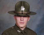 REMOVES REFERENCE TO BOOKING PHOTO - This undated photo provided by the Montana Highway Patrol shows Montana Highway Patrol Trooper Wade Palmer. Authorities say Palmer was in critical condition after being shot while investigating an earlier shooting in Missoula. Highway Patrol officials said in a statement Friday, March 15, 2019, another trooper found the wounded 35-year-old Palmer in his patrol car outside a bar in Evaro, Mont. The wife of trooper Palmer, who is now recovering from a traumatic brain injury after being shot three times, is thanking the medical team who gave them