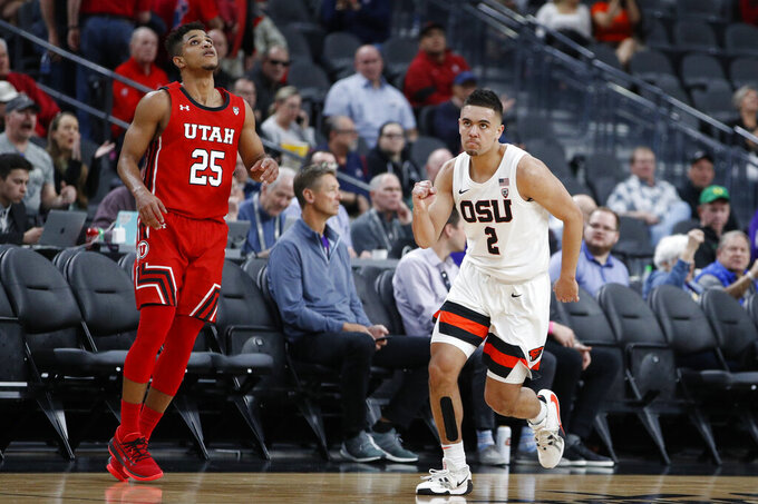 Oregon State's Jarod Lucas (2) celebrates after a play against Utah during the second half of an NCAA college basketball game in the first round of the Pac-12 men's tournament Wednesday, March 11, 2020, in Las Vegas. (AP Photo/John Locher)