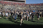 Colorado fans storm the field after overtime of an NCAA college football game against Nebraska Saturday, Sept. 7, 2019, in Boulder, Colo. Colorado won 34-31 in overtime. (AP Photo/David Zalubowski)